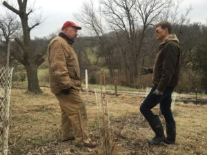 Discussing a shrub and tree planting for wildlife habitat, snow catchment, and wind protection with a Prudenterra client, on their central Iowa acreage.